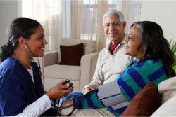 caregiver with two elderly